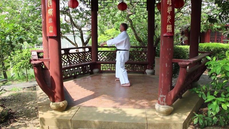 Sensei Aleksandr Grib. Kanryo Higaonna Sanchin kata in the Chinese park in Okinawa, 2019